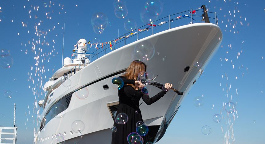 launch of megayacht Dragon at Columbus Yachts with violinist playing