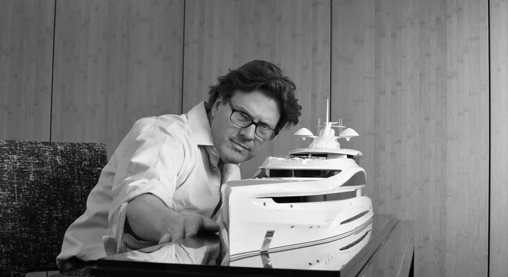 Steve Gresham of Gresham Yacht Design looks over a scale model of a superyacht