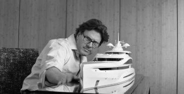 Steve Gresham of Gresham Yacht Design looks over a scale model of a superyacht