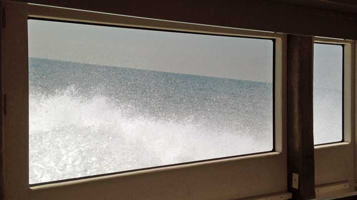 the view out one of the windows of the Amer Cento megayacht hull number 15