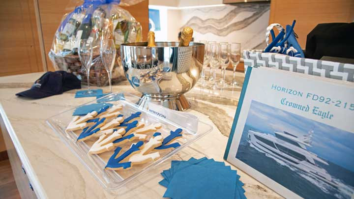 the owners of the Horizon FD92 megayacht Crowned Eagle received gifts at the christening ceremony