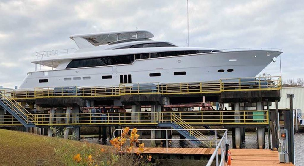 the Hatteras 105 Raised Pilothouse megayacht on a barge